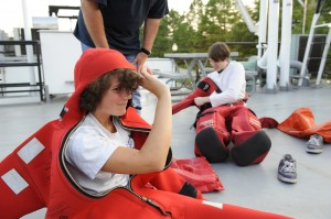 Rachel Yucuis (foreground) and Zach Rodenburg complete safety training in preparation for a research cruise on Lake Michigan.