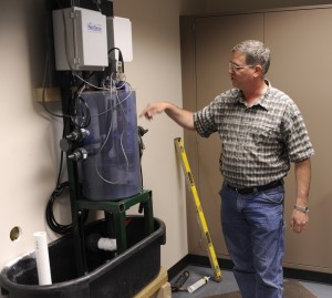 Director Doug Schnoebelen demonstrates how Mississippi River water is tested at LACMRERS.