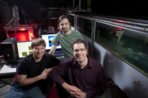 James Buchholz (right) with two members of his student research team, Craig Wojcik and Jordan Null, in the lab.