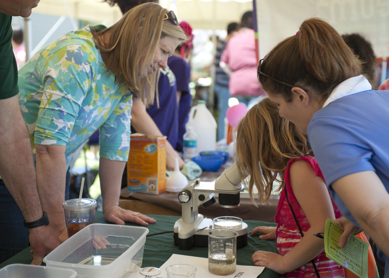 A child checks out what is under the microscope at the 2014 LACMRERS IExploreSTEM Festival on Saturday, May 3.