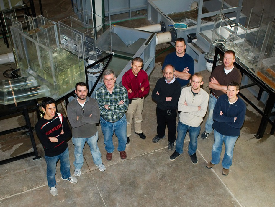 Members of the Thames Tideway Tunnel team near one of the models constructed at IIHR for this project. Andrew Craig (second from left), Jacob Odgaard (center, in red shirt), and Troy Lyons (right) lead the IIHR team.