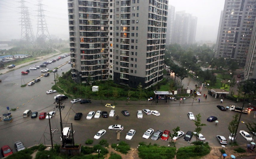 Flash flooding occurred in busy, downtown Beijing in June, 2012. Photo: EPA/CHING CHIN CHINA OUT