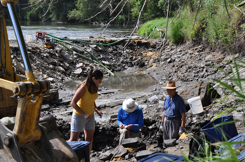 IGS researcher Paul Liu (right) with colleagues Carrie Davis and Bob McKay at the excavation site in Winneshiek County. The researchers temporarily diverted the Upper Iowa River to permit the dig.