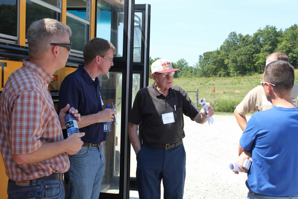 IIHR's Nathan Young (left) and Larry Weber (second from left) visit with landowners in the Soap Creek watershed in southeast Iowa. The landowners provided a tour of the farm ponds and other practices they have constructed in their watershed over the last 25 years.