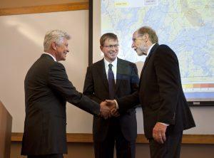 Iowa Flood Center Director Witold Krajewski (left) shakes hands with Congressman David Loebsack while IIHR Director Larry Weber looks on.