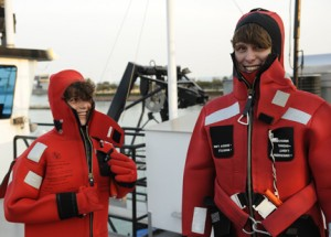 Students Zach Rodenburg and Rachel Yucuis get ready for a research cruise on Lake Michigan in Chicago at Navy Pier.