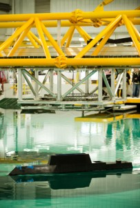 A model-scale ship goes through its paces at IIHR's wave basin.