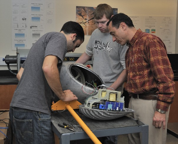 Pablo Carrica with students working on wind turbine nacelle