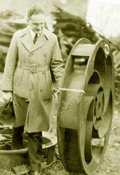 IIHR's first director and founder, Floyd Nagler, examines a turbine.