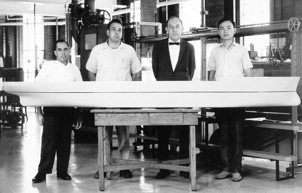 Louis Landweber (second from right) joined IIHR in the mid-1950s and initiated a major ship hydrodynamics program. This 1960s ship model was the precursor to today's highly sophisticated research models.