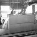 The Hydraulics Laboratory has always been known as a tidy research site; note here the well-managed conditions under which students of years past calibrated water's movement over a weir.