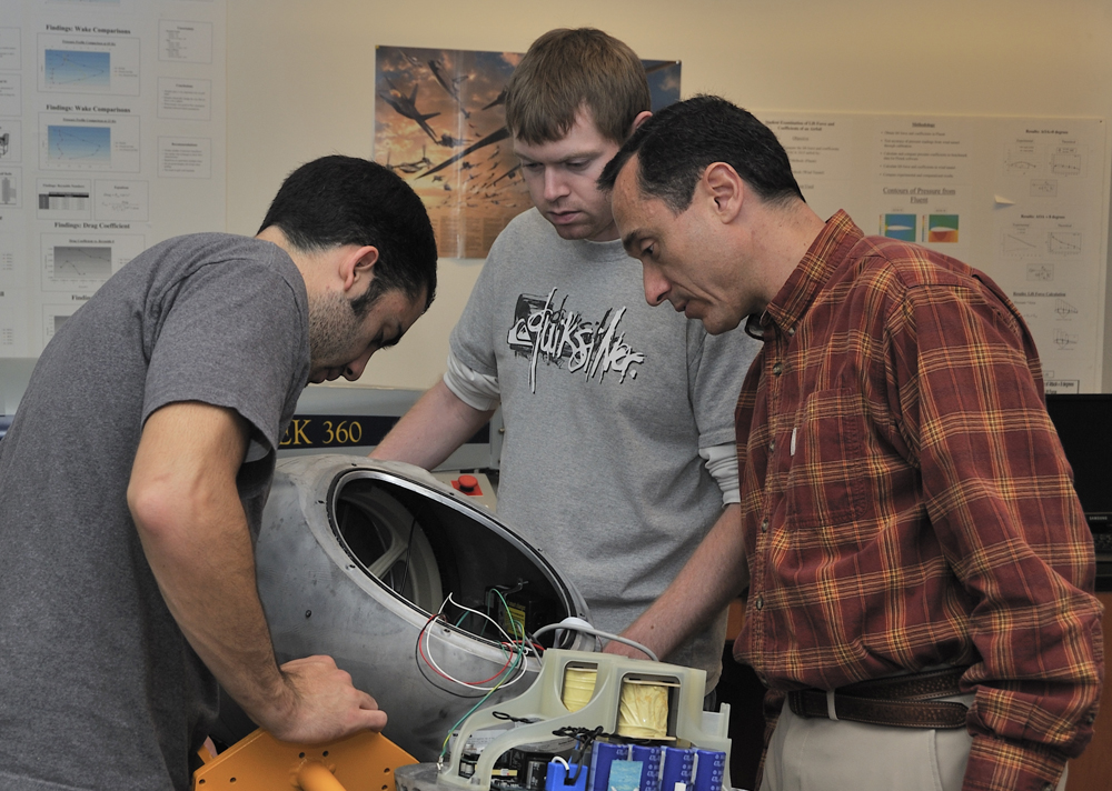 IIHR Research Engineer Pablo Carrica (right) works with students Nathan Chase and Michael Carbone in the Experimental Engineering class.