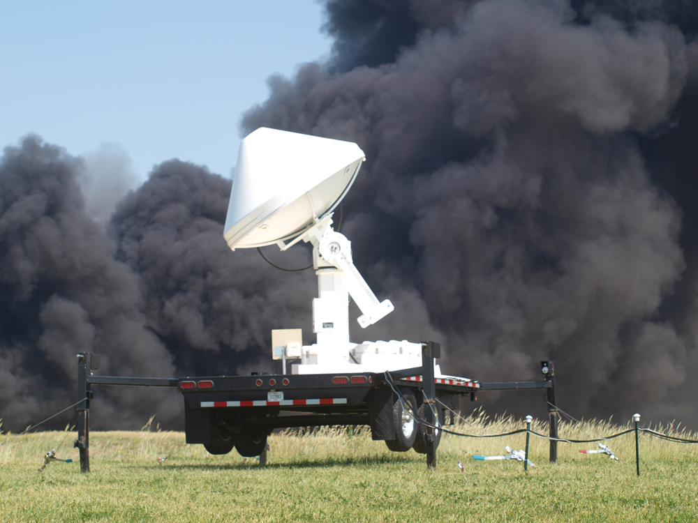 Smoke billows behind the IFC mobile weather radar unit at the Iowa City Landfill.