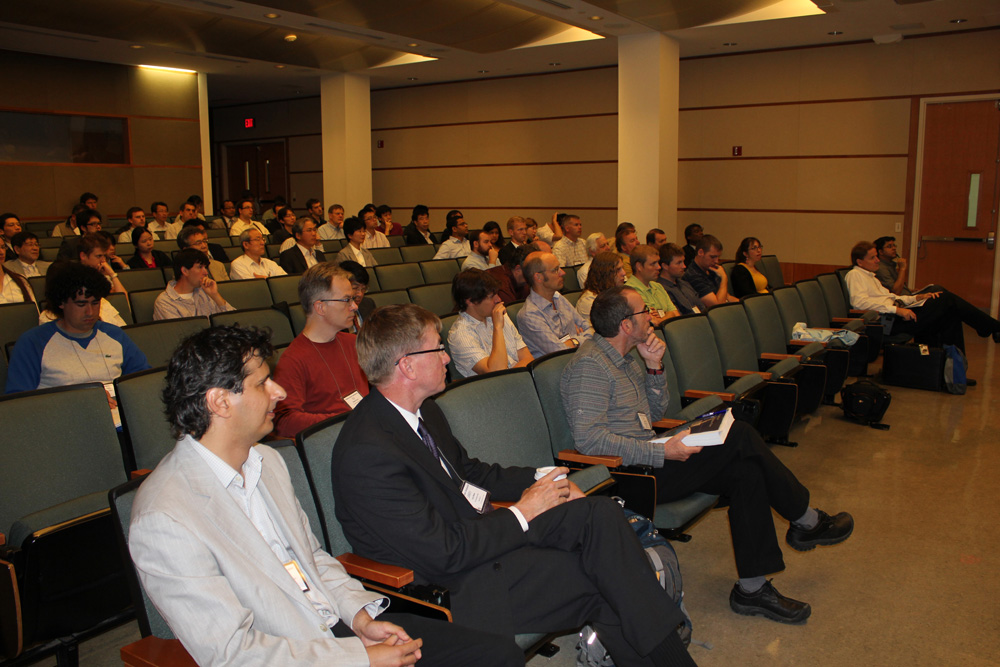 An audience watches a presentation.
