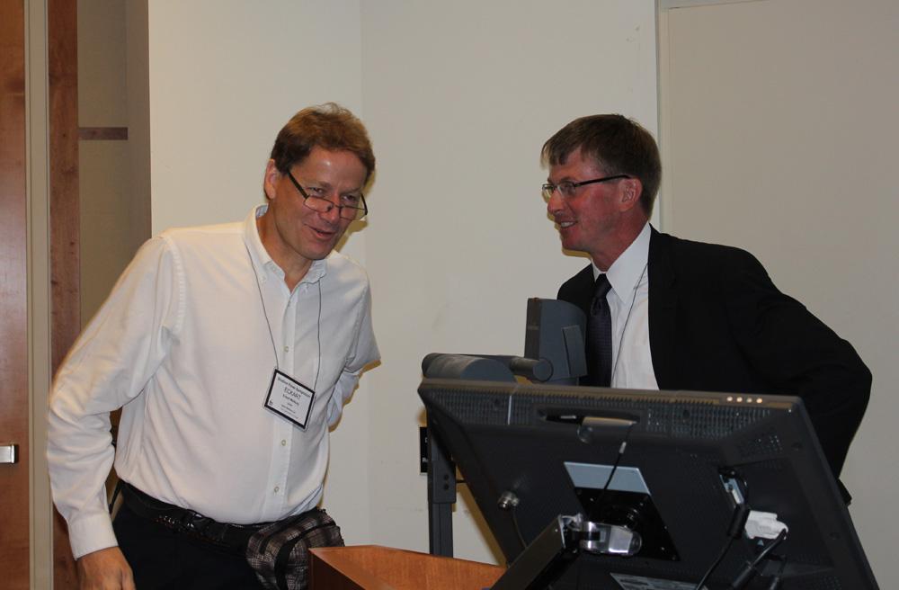 IIHR Director Larry Weber (right) greets Eckart Meiburg of the University of California-Santa Barbara.