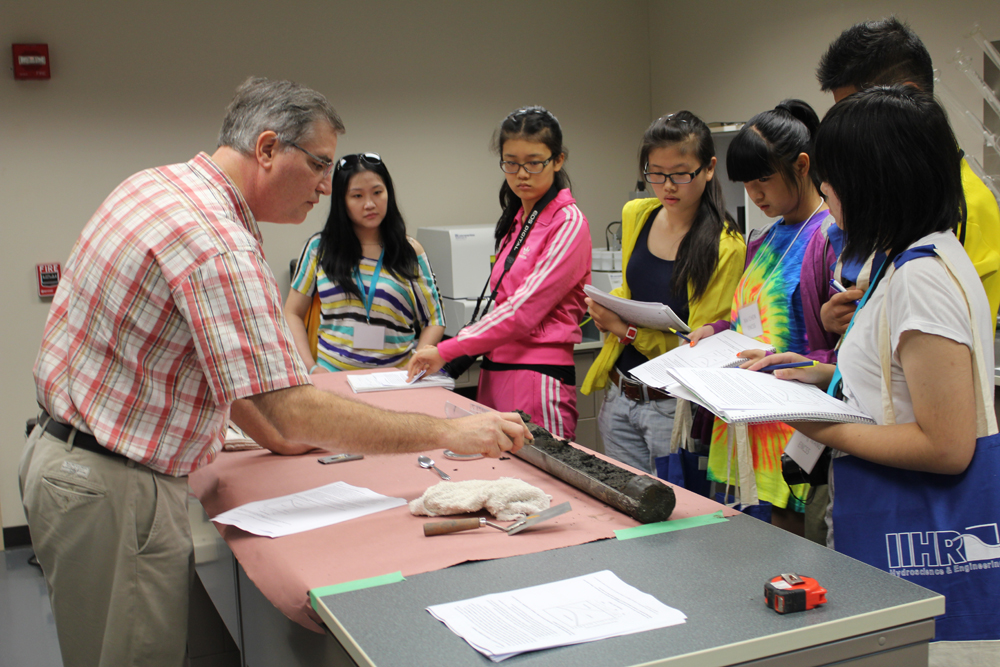 Doug Schnoebelen, left, shows visiting Chinese students sediment cores taken from the Mississippi River.