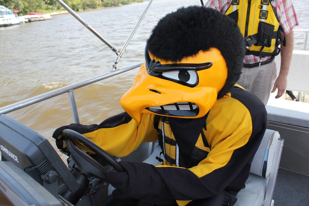 Herky's job includes all kinds of duties, such as driving one of the LACMRERS boats.