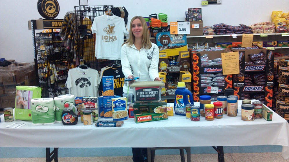 ESAC member Jenni Rumping with some of the food collected at Hy-Vee.