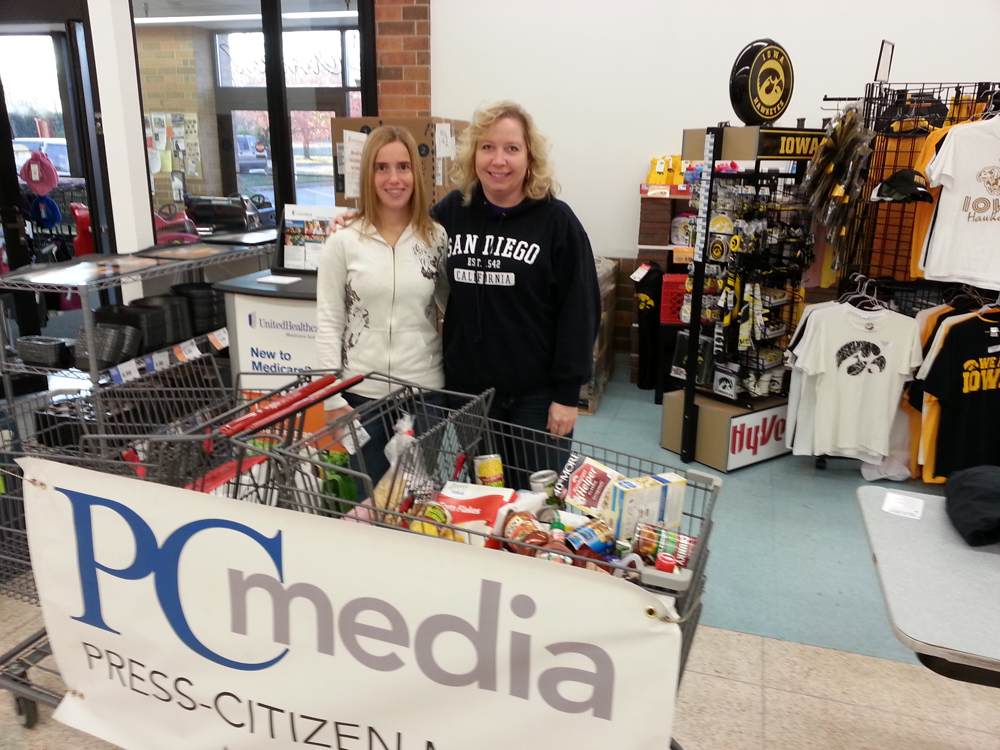 ESAC members Jennifer Rumping and Sandy Gerard with food donated at Hy-Vee.