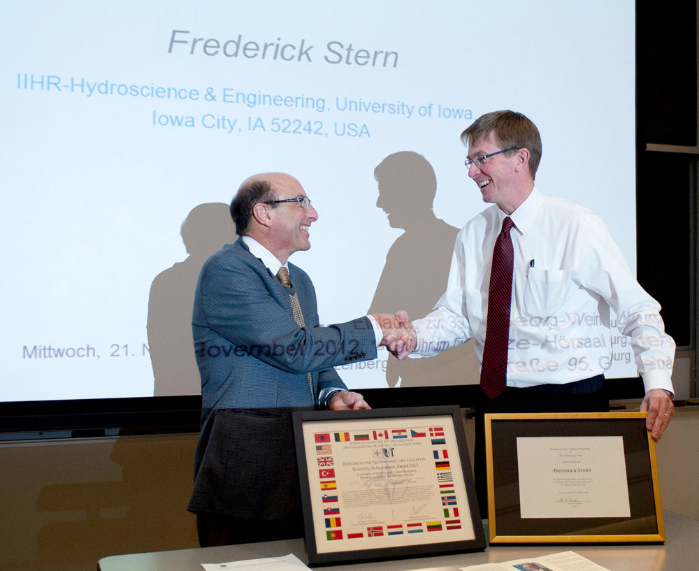 IIHR Director Larry Weber (right) congratulates Professor Fred Stern on being selected as the Ashton Professor in Hydroscience and Engineering.
