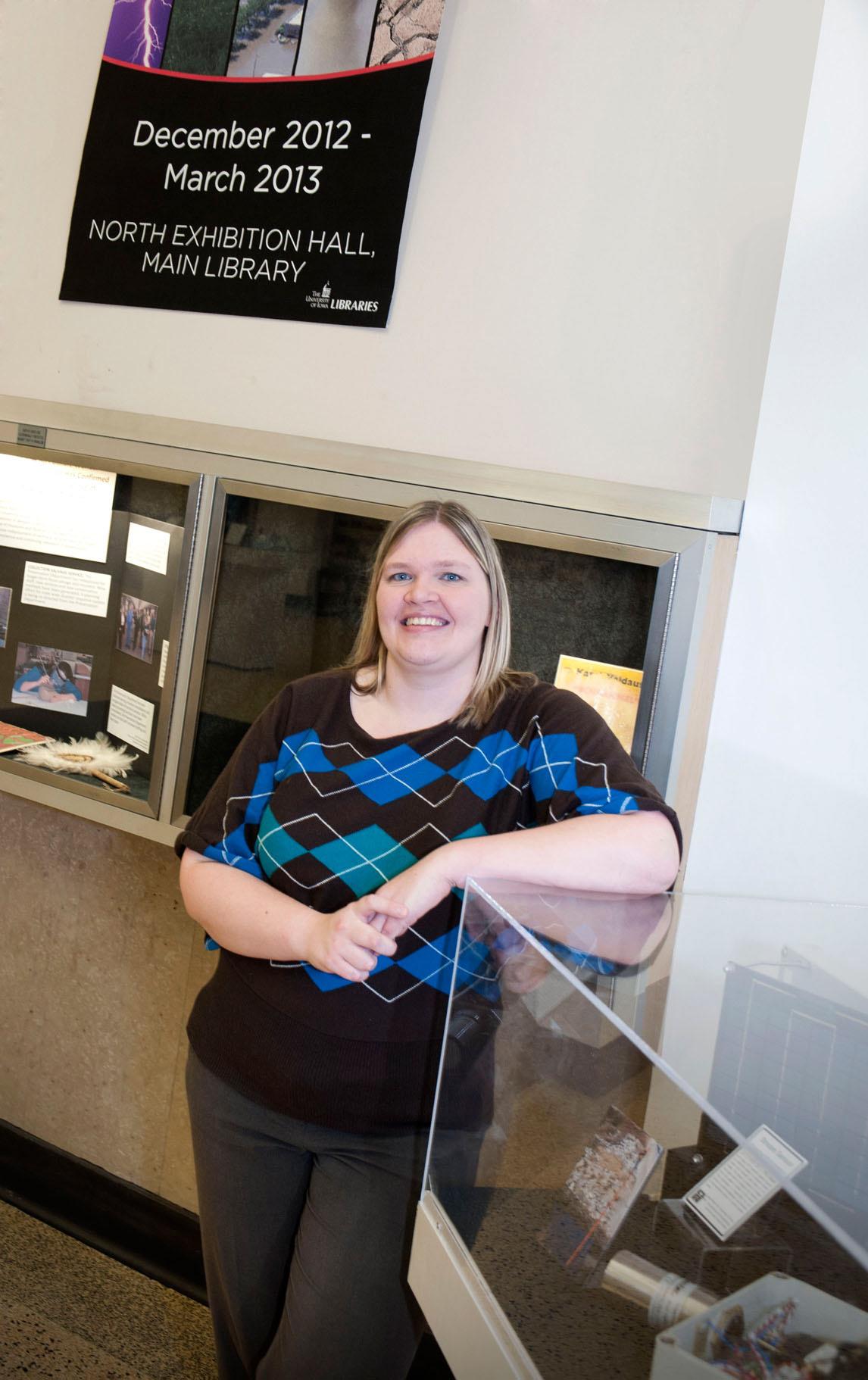 """Kari Kozak at the """"Wicked Weather"""" exhibit."""