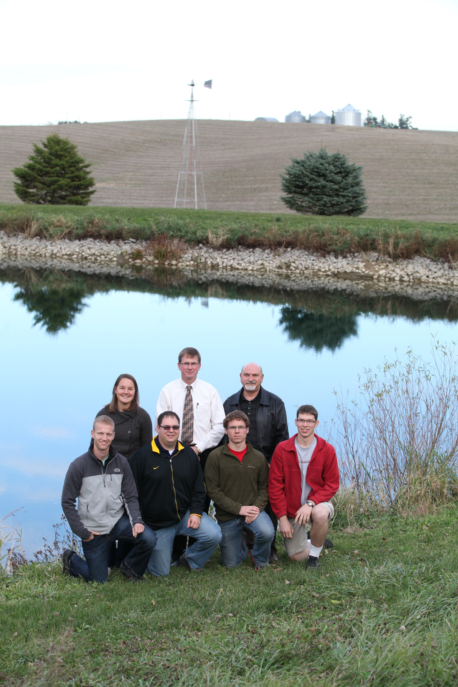 Several IIHR researchers by a lake.