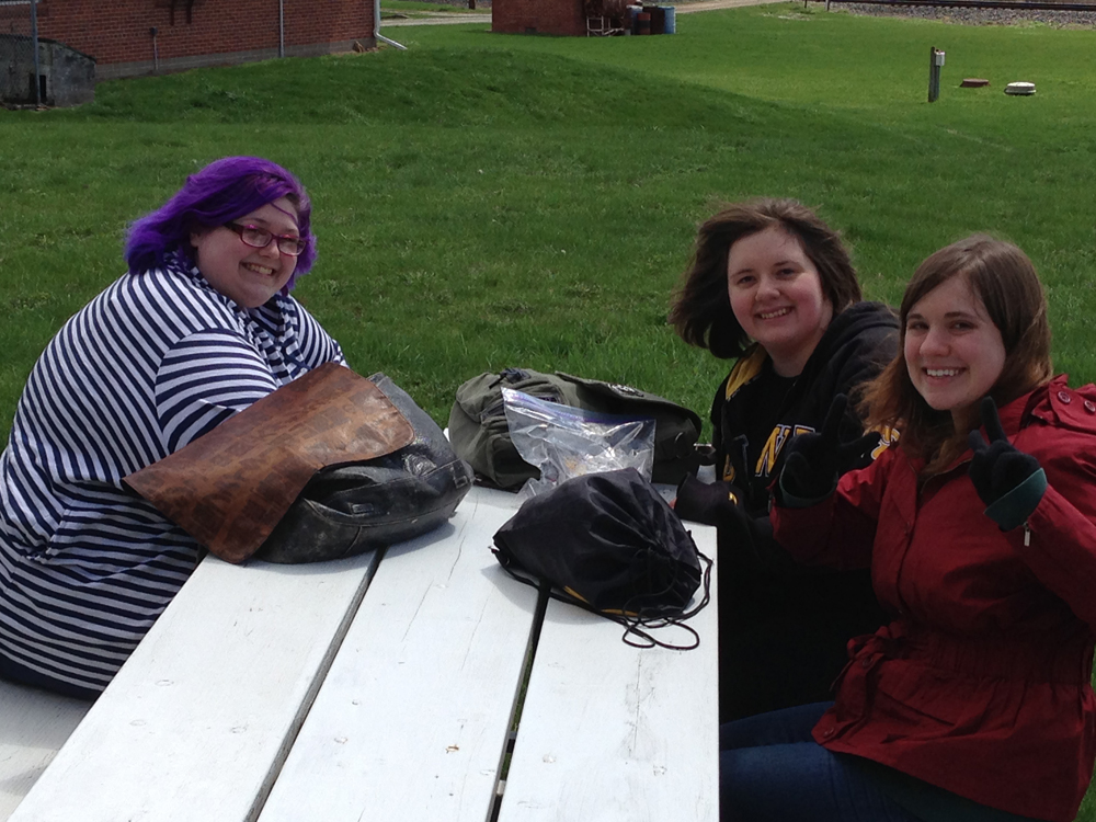 Students sit at a bench.