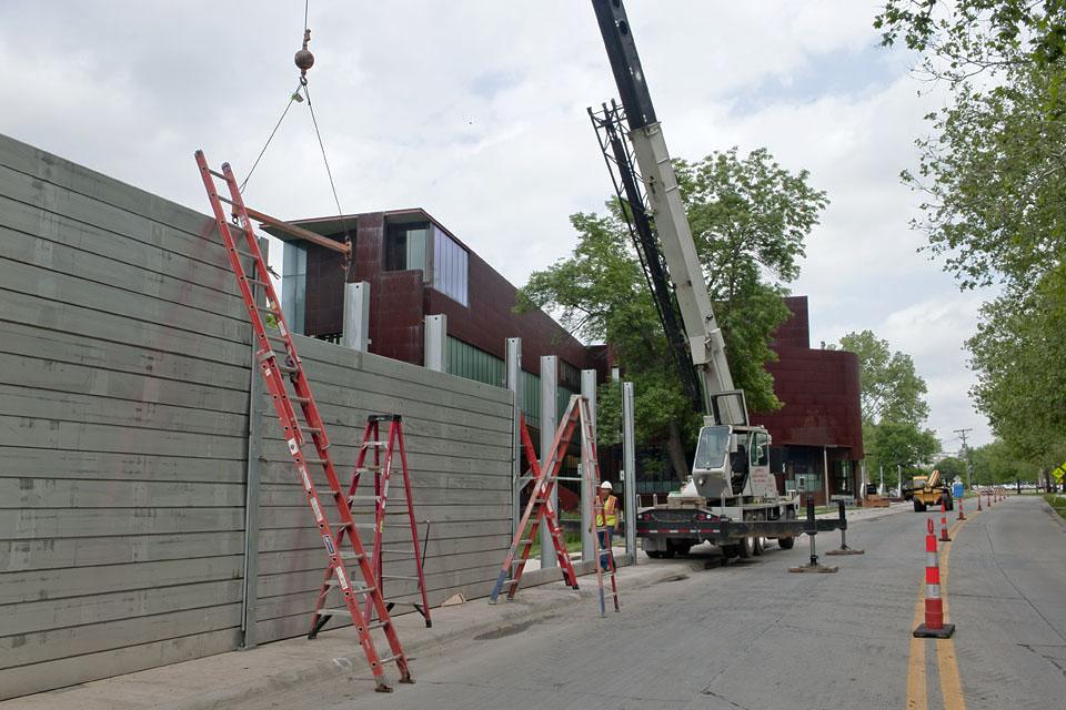 Crews erect a flood wall around Art Building West