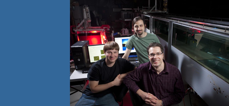 James Buchholz (right) with student researchers Craig Wojcik and Jordan Null.