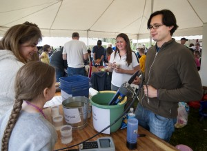 Postdoc Carrie Davis (left) and IIHR grad student Oscar Hernandez demonstrate the use of a nutrient monitoring sensor. Photo by Aneta Goska, Iowa Flood Center.