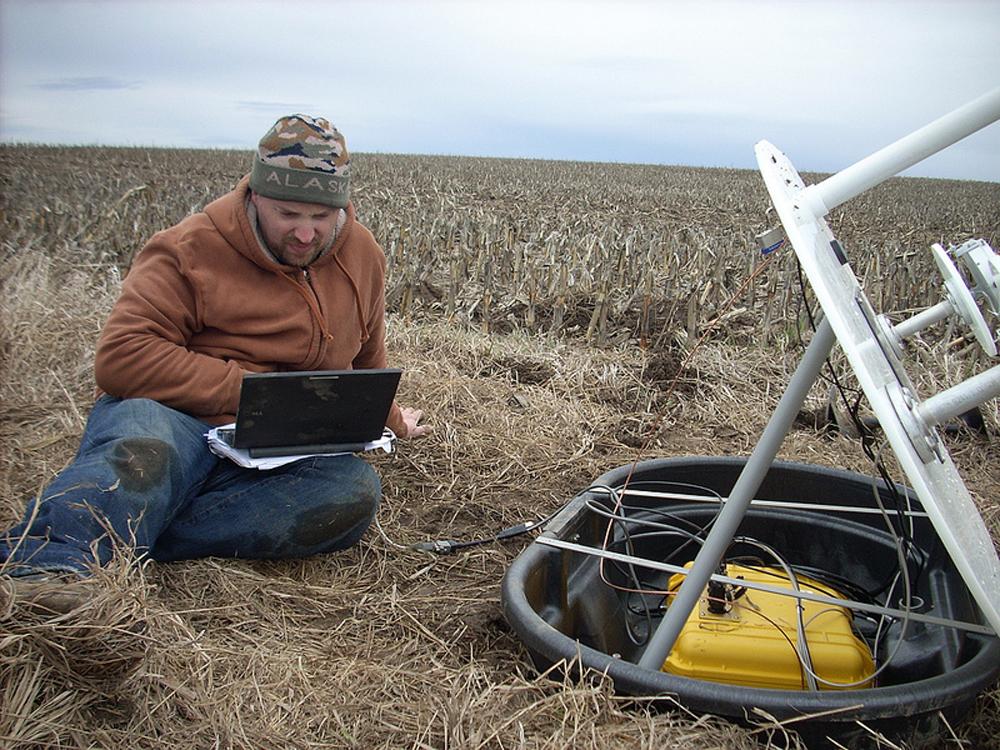 Installing one of the Iowa Flood Center's rain gauges/soil moisture probes.