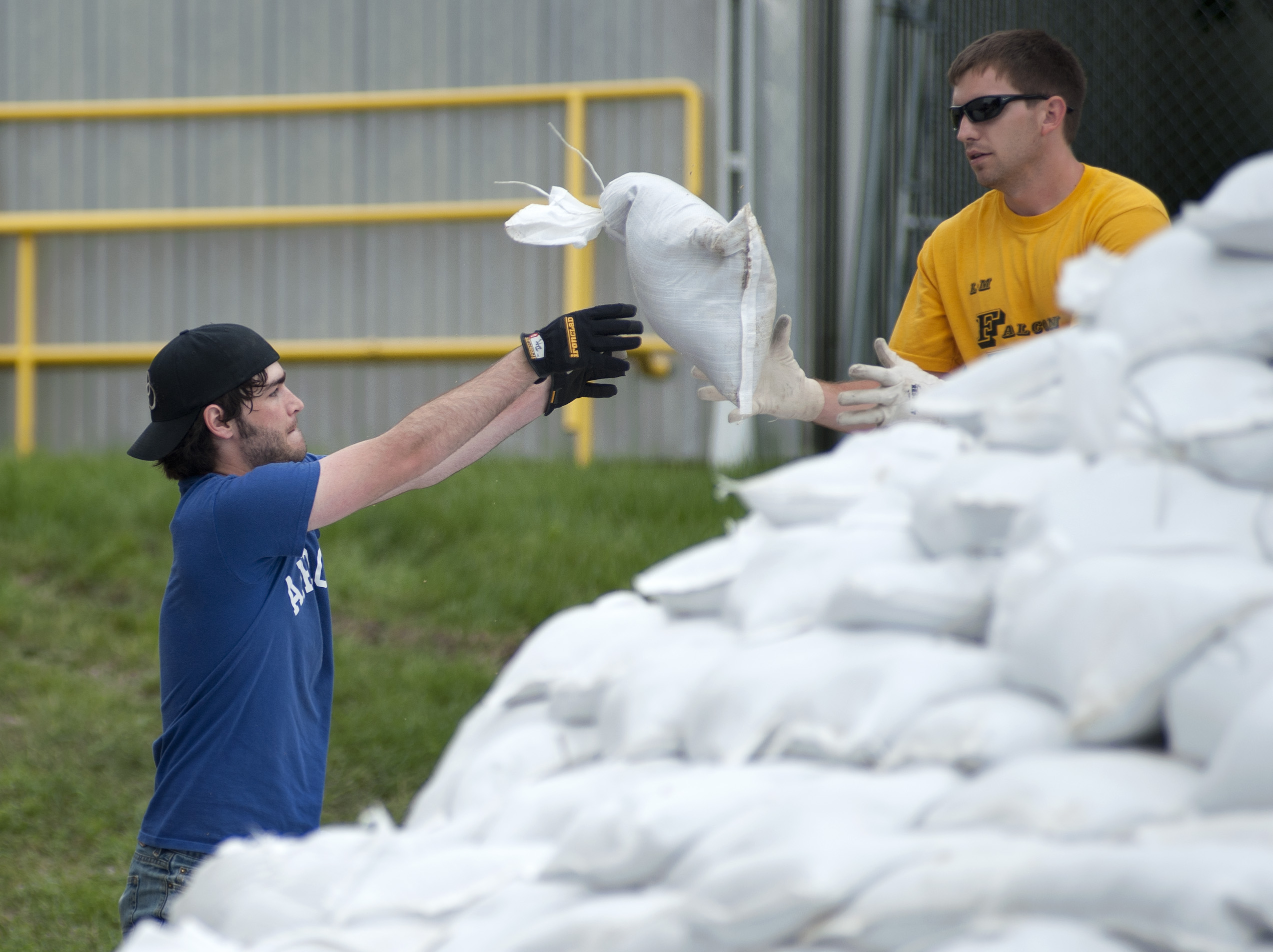 Students from across campus, including IIHR, have volunteered to help protect UI buildings by filling and stacking sandbags.