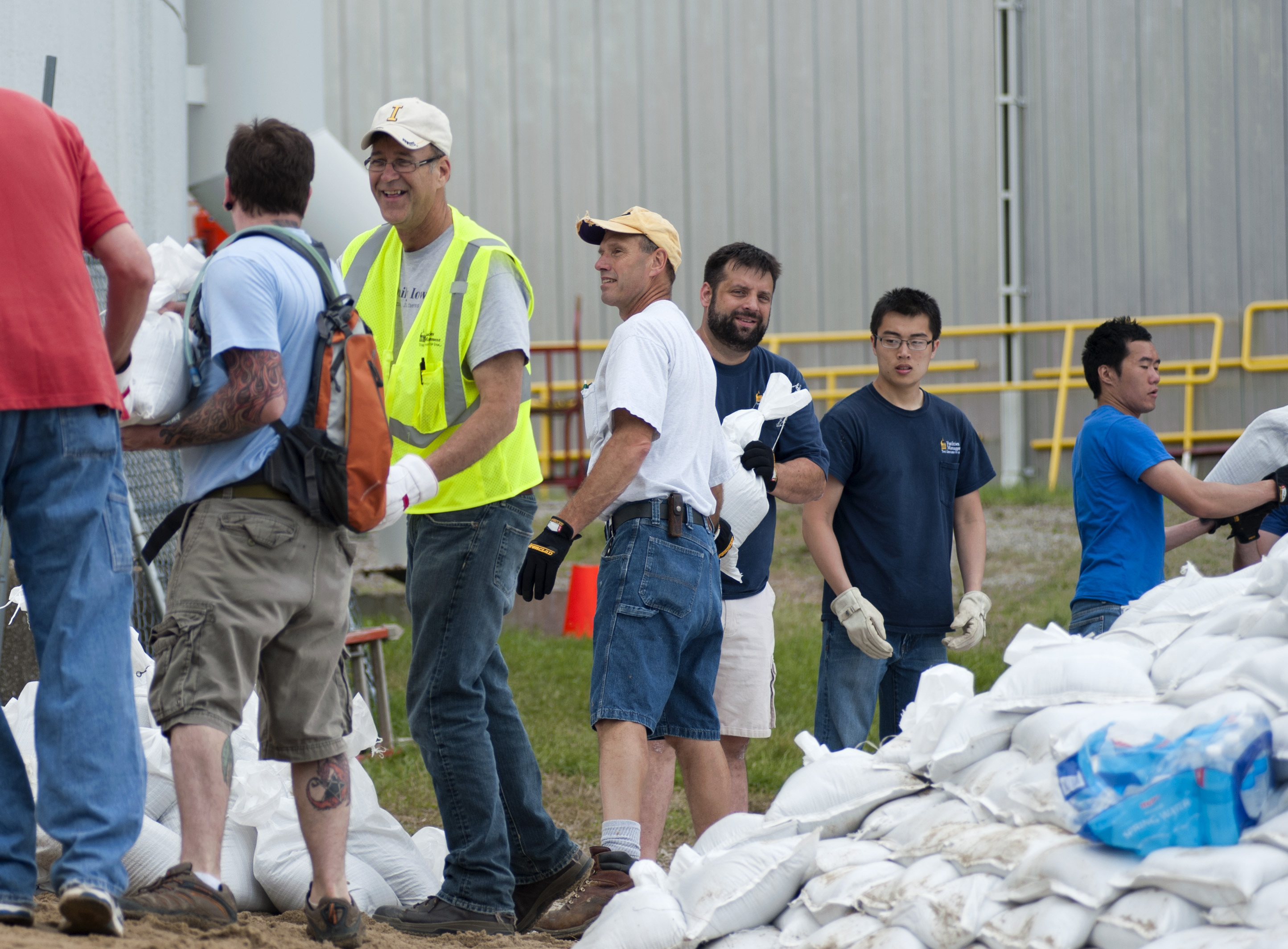 Volunteers and university employees pitch in to protect University buildings.
