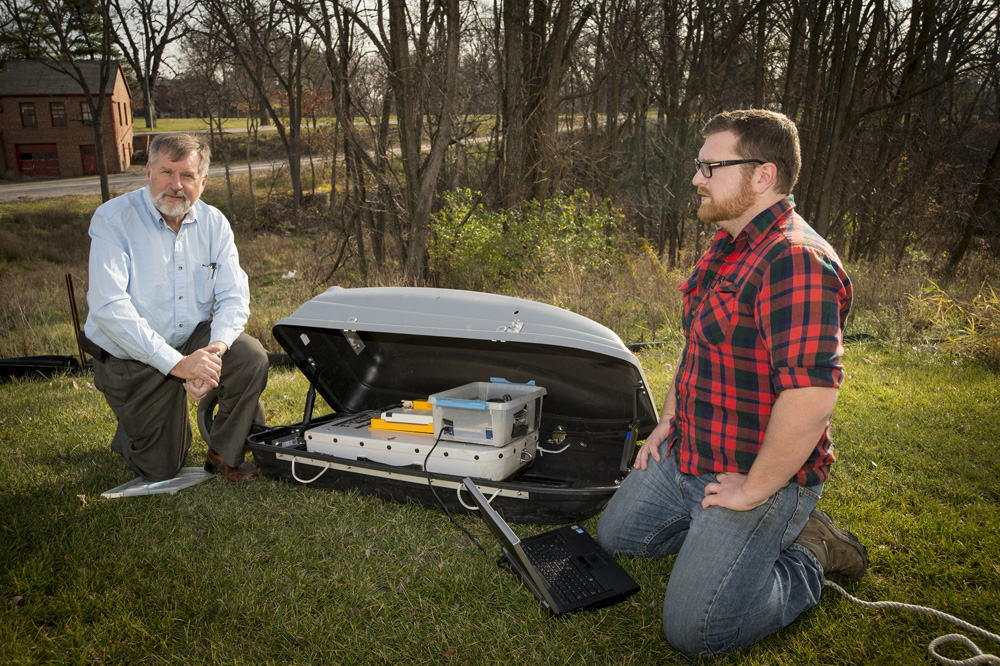 Frank Weirich (left) and student Phil Kerr check the ground-pentrating radar unit in its reinforced transport sled.