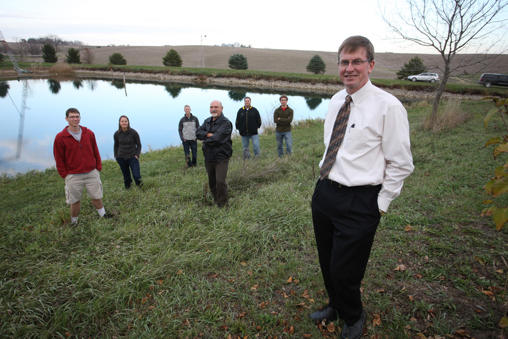 IIHR Director Larry Weber (right) leads the Iowa Watersheds Project, which is focused on how farm ponds and other constructed improvements can make a difference in reducing flood damage. Team members include: (l to r) Chad Drake, Sara Steussy, Nick Thomas, Marian Muste, Matt Wunsch, and Will Klingner.