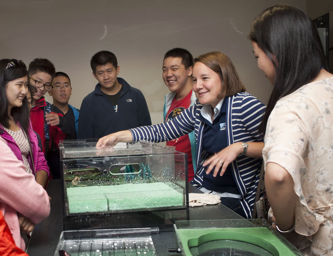 Sara Steussy (right) leads the students in a hands-on activity.