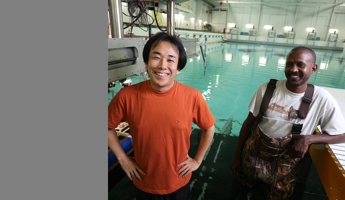 IIHR Associate Research Scientist Yugo Sanada (left) and graduate student Haitham Elshiekh at the IIHR Wave Basin.