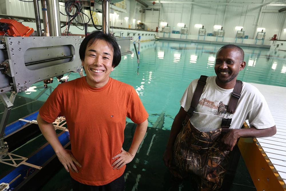 IIHR Associate Research Engineer Yugo Sanada (left) and graduate student Haitham Elshiekh at the IIHR Wave Basin.