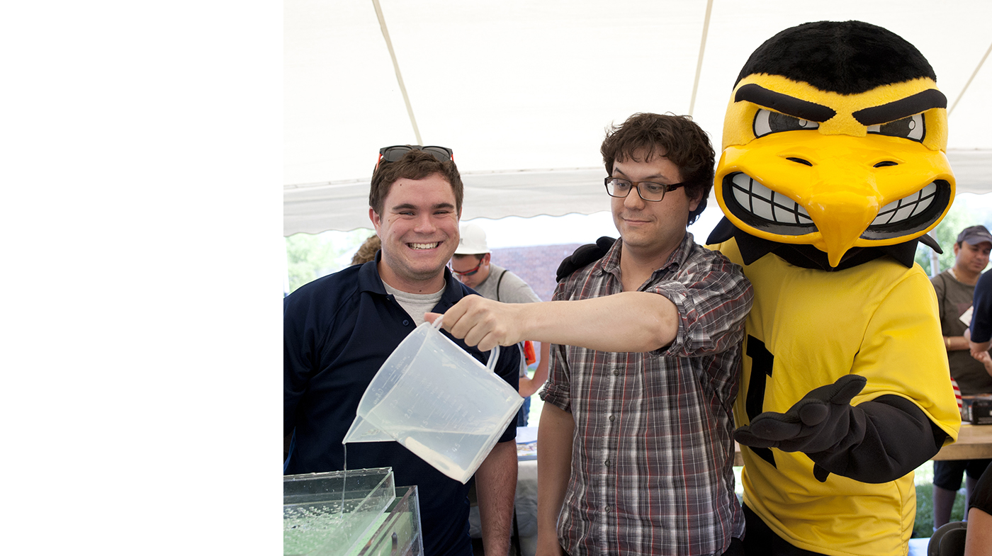 Herky with two men.