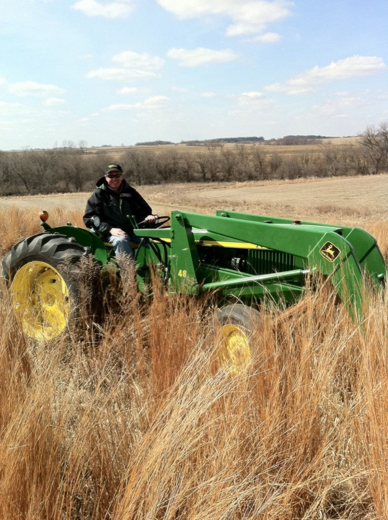Larry Weber looks quite at home behind the wheel of his tractor.
