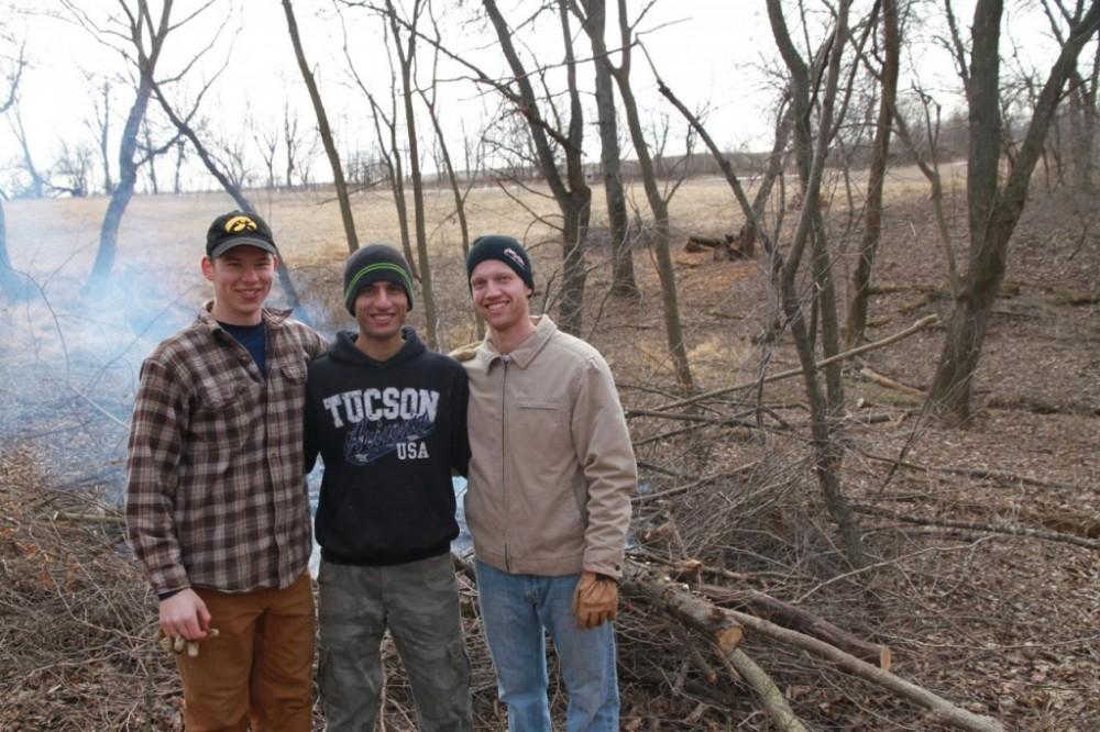 IIHR students Chad Drake, Ali Reza Firoozfar, and Nick Thomas helping with restoration work at Old Man's Timber.
