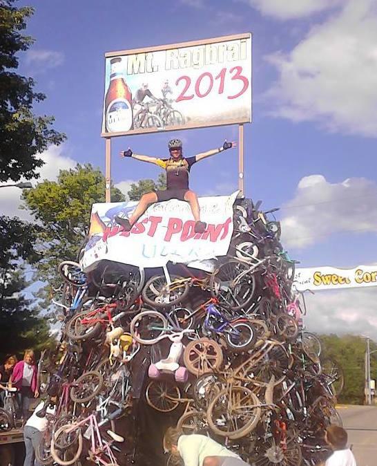 Ricardo Mantilla sits atop a pile of bikes at Ragbrai.