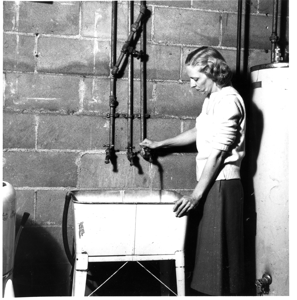 """Plumbing research was a centerpiece of IIHR's industry-oriented research in the 1930s, here carried out in a """"model house"""" for plumbing studies."""