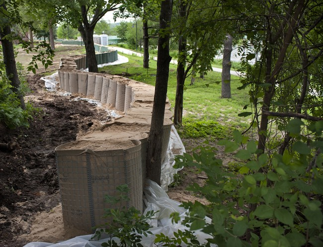 HESCO barriers create a temporary flood wall to protect campus buildings.