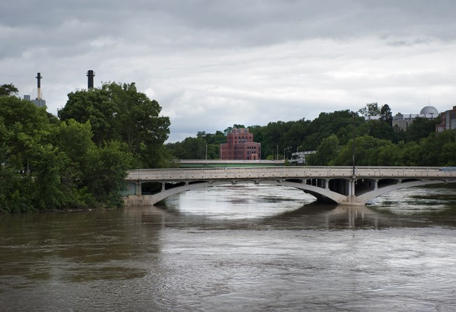 The swollen Iowa River as it winds through the University of Iowa campus, July 2, 2014.