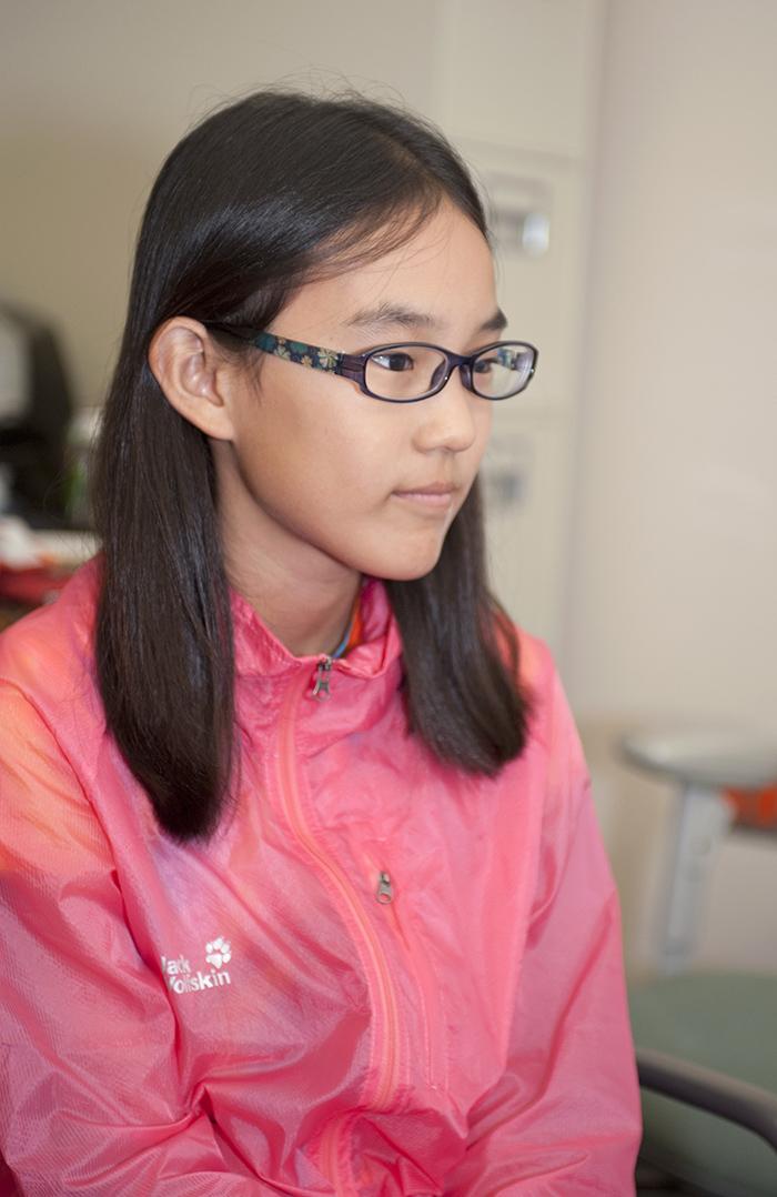 Annie Li looking on.