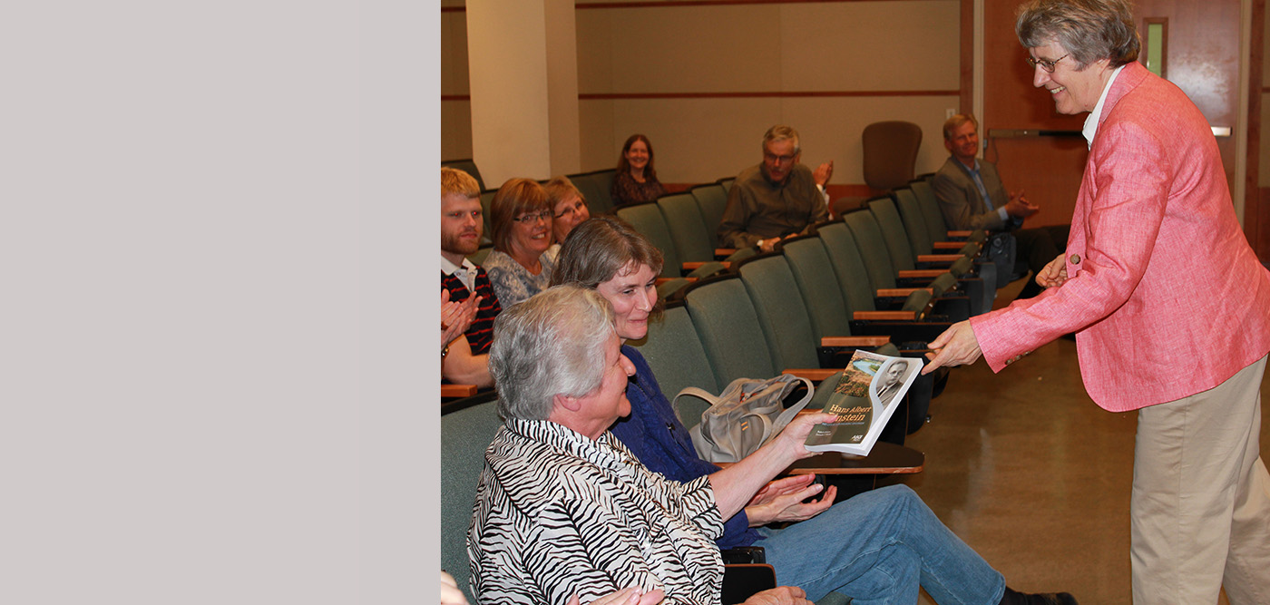 Co-author Connie Mutel (right) presents a copy of the book to Mrs. Nancy Kennedy.