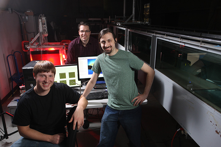 IIHR Assistant Research Engineer James Buchholz (center) working with graduate students Craig Wojcek and Jordan Null. They are using particle image velocimetry (PIV) to visualize flow.