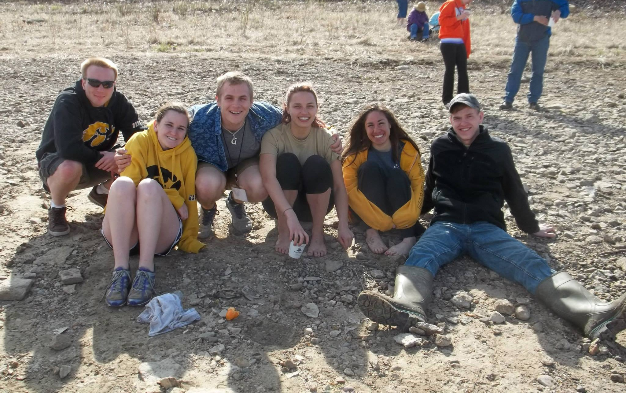 """Stephanie Then and the rest of the UI ASCE concrete canoe rowing team with their design—the """"Pocahontas""""—in 2013."""