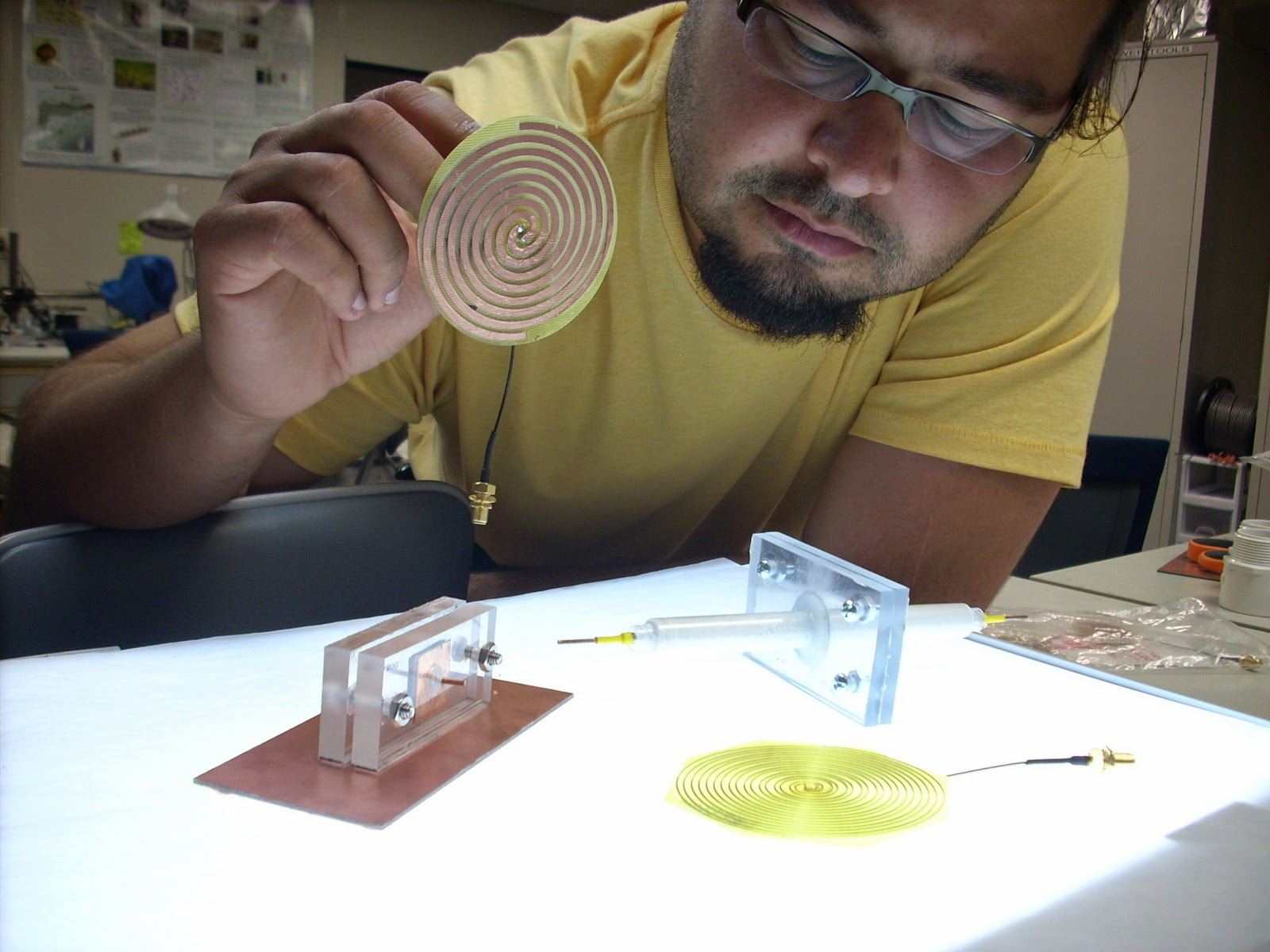 Llamas works with his curved spiral antenna design in the IIHR Wind Tunnel Annex.